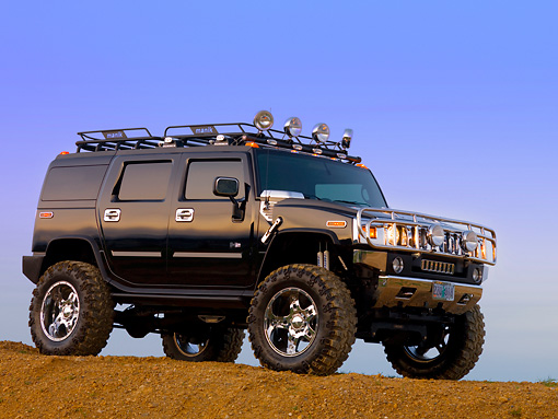 AUT 15 RK1108 01 © Kimball Stock 2007 Hummer H2 Black Low 3/4 Front View On Dirt Hill