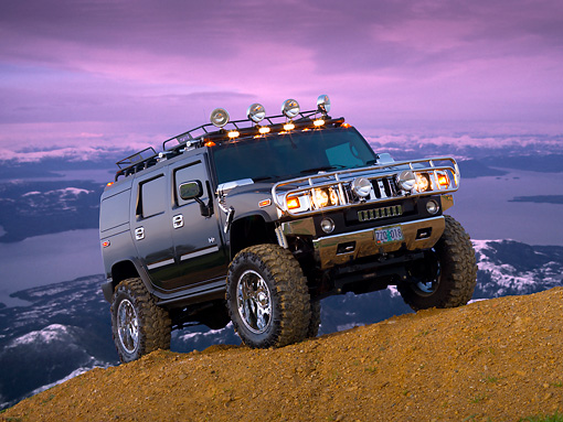 AUT 15 RK1110 01 © Kimball Stock 2007 Hummer H2 Black Low 3/4 Front View On Dirt Hill