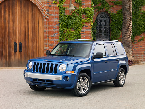 AUT 15 RK1125 01 © Kimball Stock 2007 Jeep Patriot Blue 3/4 Front View On Pavement By Winery
