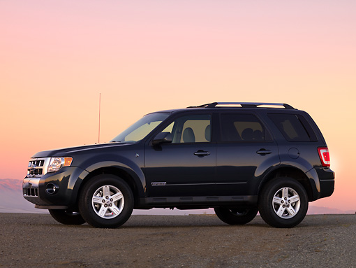 AUT 15 RK1149 01 © Kimball Stock 2010 Ford Escape Hybrid SUV Black 3/4 Front View On Pavement At Sunset