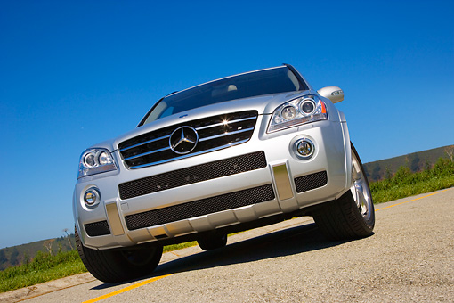 AUT 15 RK1155 02 © Kimball Stock 2007 Mercedes-Benz ML63 AMG SUV Silver Low Head On View On Pavement