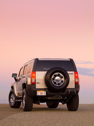 AUT 15 RK1157 01 © Kimball Stock 2007 Hummer H3 Silver 3/4 Rear View On Pavement At Dusk