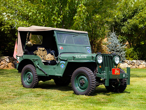 AUT 15 RK1164 01 © Kimball Stock 1949 Willys Jeep P-2 Army Green Front 3/4 View On Grass By Trees