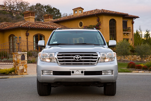 AUT 15 RK1174 01 © Kimball Stock 2008 Toyota Land Cruiser Silver Head On View By House