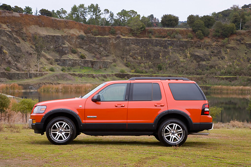AUT 15 RK1180 01 © Kimball Stock 2008 Ford Explorer Ironman Orange Profile View By Quarry