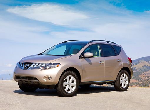 AUT 15 RK1193 01 © Kimball Stock 2009 Nissan Murano Champagne 3/4 Front View By Mountain Blue Sky