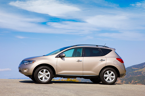AUT 15 RK1195 01 © Kimball Stock 2009 Nissan Murano Champagne 3/4 Front View By Mountain Blue Sky