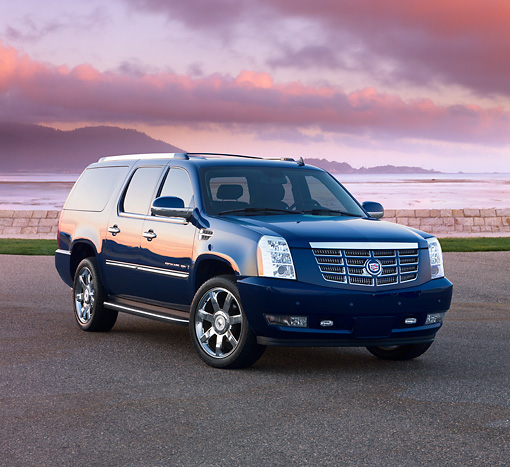 AUT 15 RK1205 01 © Kimball Stock 2007 Cadillac Escalade ESV Blue 3/4 Front View By Water