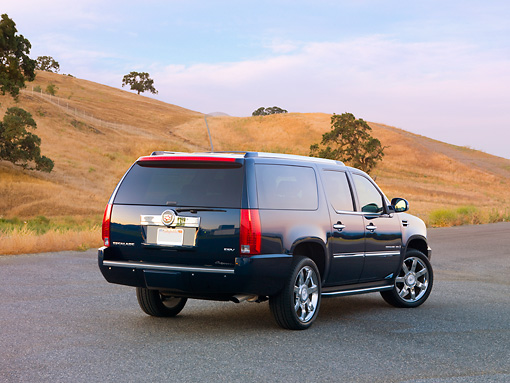 AUT 15 RK1206 01 © Kimball Stock 2007 Cadillac Escalade ESV Blue 3/4 Rear View By Hills