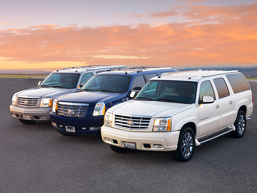 AUT 15 RK1209 01 © Kimball Stock 2004, 2007 & 2004 Cadillac Escalades 3/4 Front View At Dusk