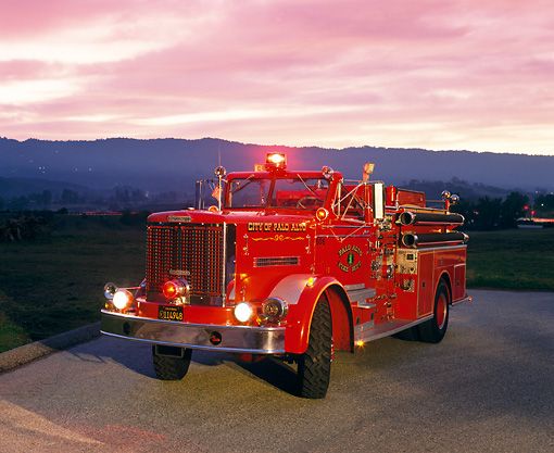 AUT 16 RK0097 03 © Kimball Stock 1961 Oshkosh 120 GPM Pumper Front 3/4 View On Pavement At Dusk