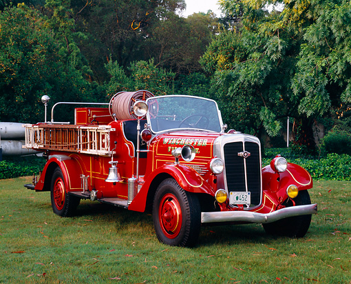 AUT 16 RK0119 04 © Kimball Stock 1935 Ahrens-Fox 650 GPM Pumper 3/4 Front View On Grass