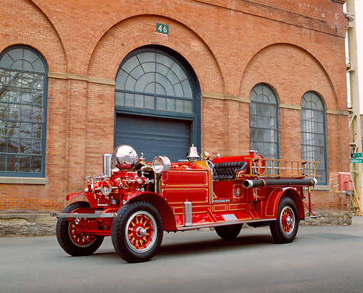 AUT 16 RK0127 01 © Kimball Stock 1923 Arhens Fox Fire Engine Red 3/4 Front View On Pavement By Brick Building