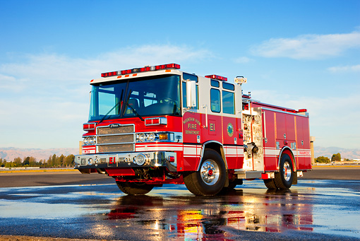 AUT 16 RK0173 01 © Kimball Stock 2009 Pierce Quantum Pumper 1500 GPM Fire Truck 3/4 Front View On Wet Pavement