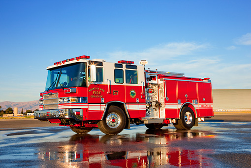 AUT 16 RK0175 01 © Kimball Stock 2009 Pierce Quantum Pumper 1500 GPM Fire Truck 3/4 Front View On Wet Pavement