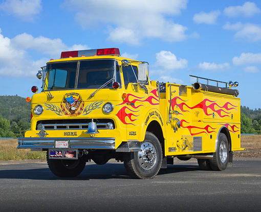 AUT 16 RK0189 01 © Kimball Stock 1973 Ford Howe Fire Engine Yellow With Red Flames 3/4 Front View On Pavement