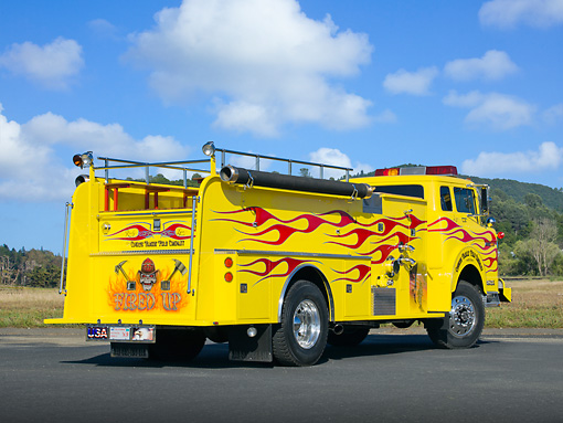AUT 16 RK0191 01 © Kimball Stock 1973 Ford Howe Fire Engine Yellow With Red Flames 3/4 Rear View On Pavement