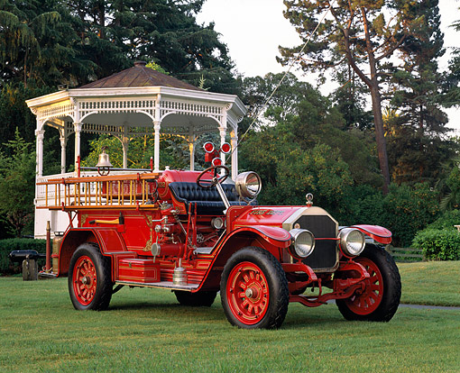 AUT 16 RK0193 01 © Kimball Stock 1922 American LaFrance Pumper Fire Truck Red 3/4 Front View On Grass By Gazebo