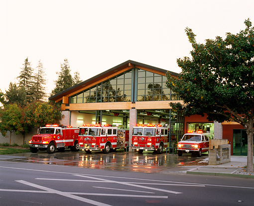 AUT 16 RK0002 03 © Kimball Stock Four Fire Trucks Red 3/4 View By Fire Station