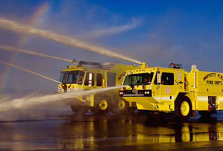 AUT 16 RK0028 16 © Kimball Stock 1997 Oshkosh T-1000 #8 And 1998 Teledyne P-23 #9 Crash Truck Yellow 3/4 Front View Spraying Water