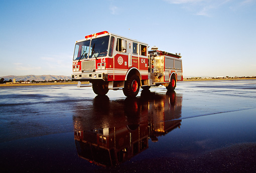 AUT 16 RK0034 01 © Kimball Stock 1994 KME P-24 Pumper #4 Fire Truck Red 3/4 Front View On Wet Pavement