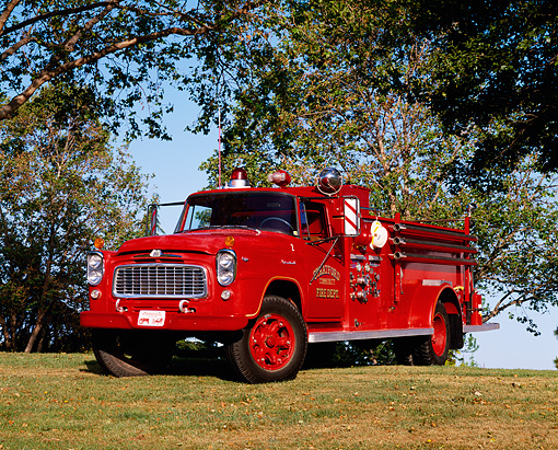 AUT 16 RK0044 05 © Kimball Stock 1960 International Fire Engine Truck 3/4 Front View On Grass By Trees
