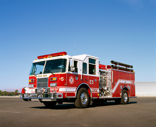 AUT 16 RK0045 06 © Kimball Stock 2000 Pierce Saber 1500 GPM Pumper Fire Truck Red 3/4 Front View On Pavement Blue Sky