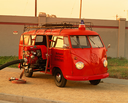 AUT 16 RK0046 04 © Kimball Stock 1958 Volkswagen Fire Truck Safety Vehicle Red 3/4 Front View By Wall