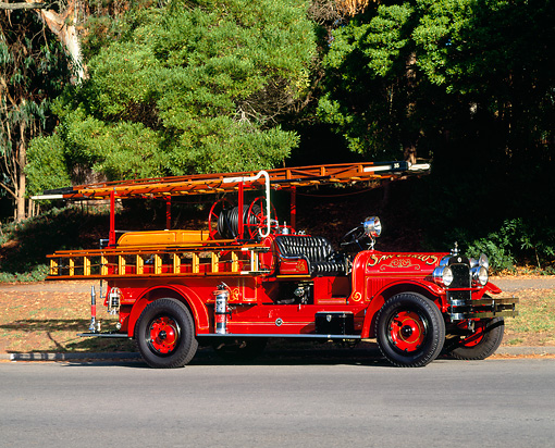 AUT 16 RK0065 02 © Kimball Stock 1927 Seagrave San Carlos Fire Department On Road By Trees
