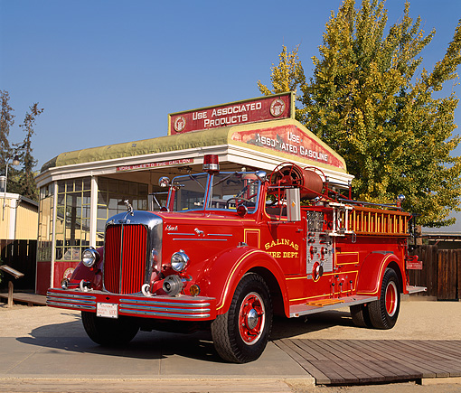 AUT 16 RK0077 04 © Kimball Stock 1951 Mack Fire Truck 3/4 Front View By Old Gas Station