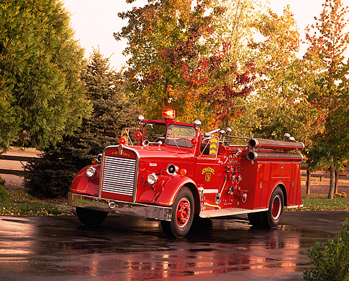 AUT 16 RK0078 10 © Kimball Stock 1952 K.W. Van Pelt Fire Truck 3/4 Front View On Wet Pavement By Trees