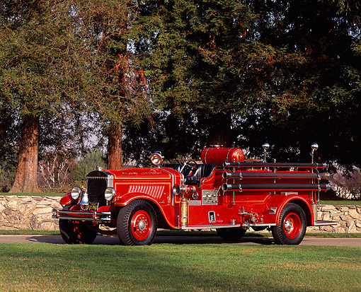 AUT 16 RK0092 03 © Kimball Stock 1931 Mack Fire Truck 3/4 Front View On Grass By Trees