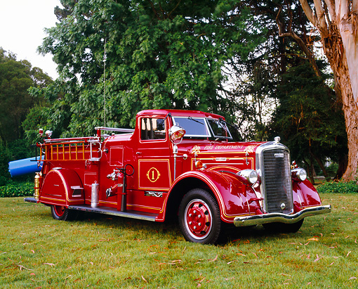 AUT 16 RK0121 01 © Kimball Stock 1939 Ward LaFrance 750 GPM Pumper 3/4 Front View On Grass