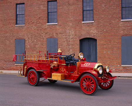 AUT 16 RK0134 01 © Kimball Stock 1909 Kissel Hose And Chemical Fire Truck Red 3/4 Front View On Pavement By Building