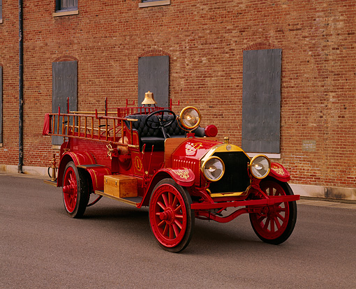 AUT 16 RK0135 01 © Kimball Stock 1909 Kissel Hose And Chemical Firetruck Red 3/4 Front View On Pavement By Brick Building
