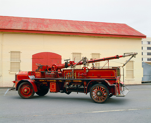 AUT 16 RK0139 03 © Kimball Stock 1927 American La France Deluge Truck Red 3/4 Rear View On Pavement By Building