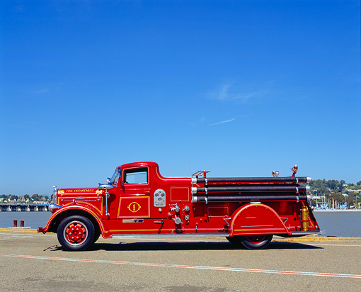 AUT 16 RK0141 03 © Kimball Stock 1935 Ward La France Fire Truck Side View On Pavement Blue Sky