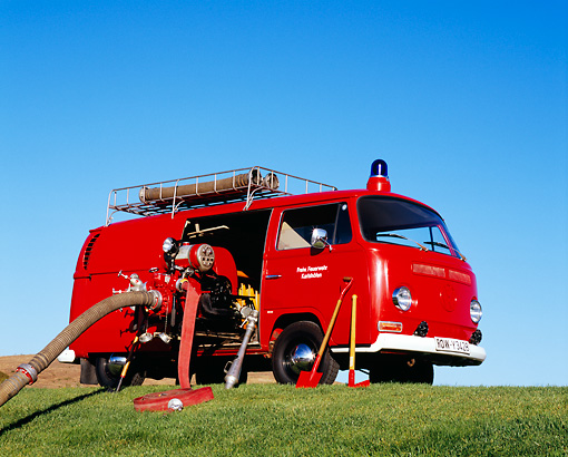 AUT 16 RK0143 08 © Kimball Stock 1969 Volkswagen German Firebus Red 3/4 Side View On Grass Hill