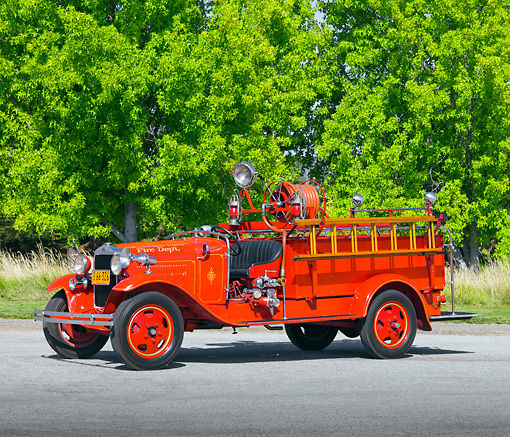 AUT 16 RK0144 01 © Kimball Stock 1930 Ford Model A Fire Truck Red 3/4 Front View By Trees