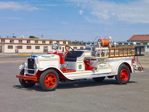 AUT 16 RK0153 01 © Kimball Stock 1929 American LaFrance Triple Combination Fire Truck White 3/4 Front View By Building