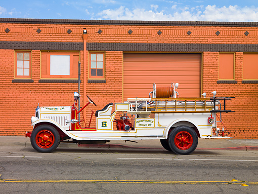 AUT 16 RK0154 01 © Kimball Stock 1929 American LaFrance Triple Combination Fire Truck White Profile View By Building