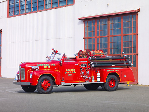 AUT 16 RK0158 01 © Kimball Stock 1954 Ahrens-Fox Fire Truck Red 3/4 Front View By Building