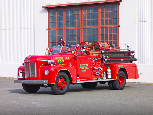AUT 16 RK0159 01 © Kimball Stock 1954 Ahrens-Fox Fire Truck Red 3/4 Front View By Building