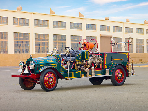 AUT 16 RK0162 01 © Kimball Stock 1916 Locomobile Fire Truck Green 3/4 Front View By Building