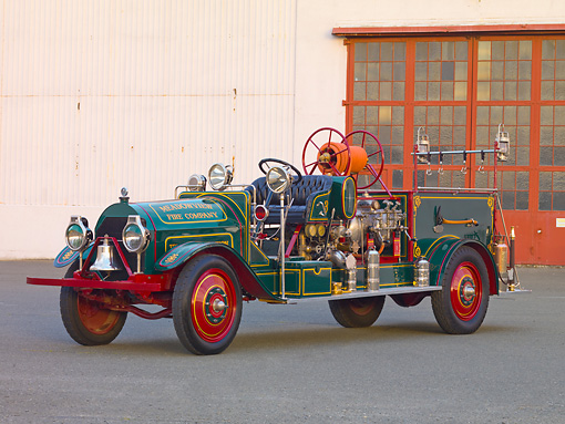 AUT 16 RK0164 01 © Kimball Stock 1916 Locomobile Fire Truck Green 3/4 Front View By Building