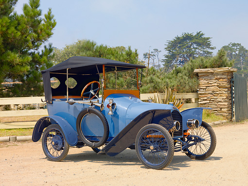 AUT 17 BK0001 01 © Kimball Stock 1914 Peugeot B�b� Type BP1 Blue 3/4 Front View On Dirt By Fence And Trees