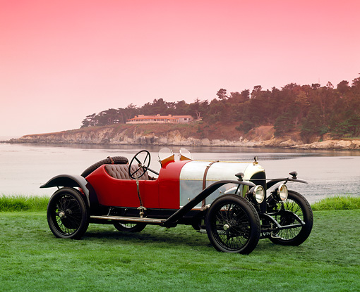 AUT 17 RK0099 02 © Kimball Stock Oldest Bentley In Existance Side 3/4 View On Grass By Water Pebble Beach