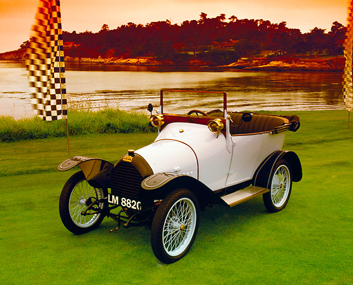 AUT 17 RK0125 01 © Kimball Stock 1914 Puegeot Bebe Cabriolet White 3/4 Front View On Grass By Water