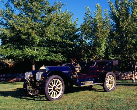 AUT 17 RK0152 01 © Kimball Stock 1910 Pierce Arrow Miniature Town Car Black 3/4 Front View On Grass By Trees