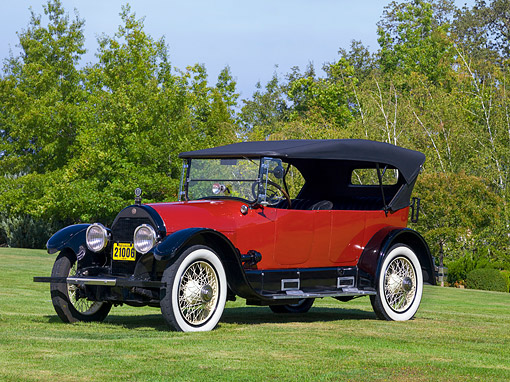AUT 17 RK0174 01 © Kimball Stock 1918 Cadillac Touring Model 57 Red Front 3/4 View On Grass By Trees Sky